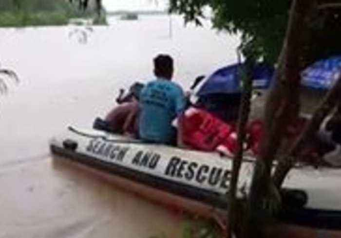 Firefighters Rescue Villagers Trapped by Flooding in The Philippines Amid Tropical Depression Usman