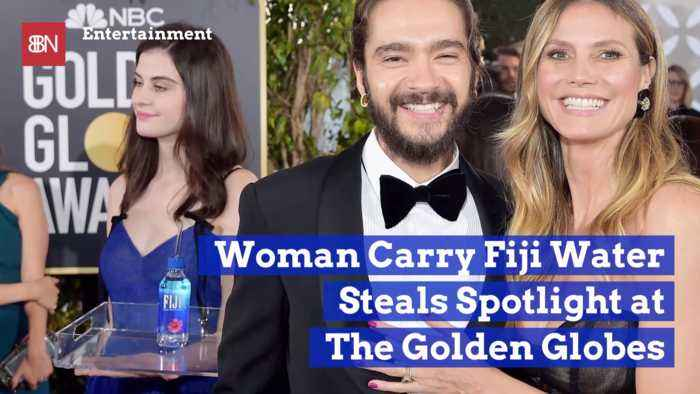 The Golden Globes Fiji Water Woman Becomes Famous Photobomber