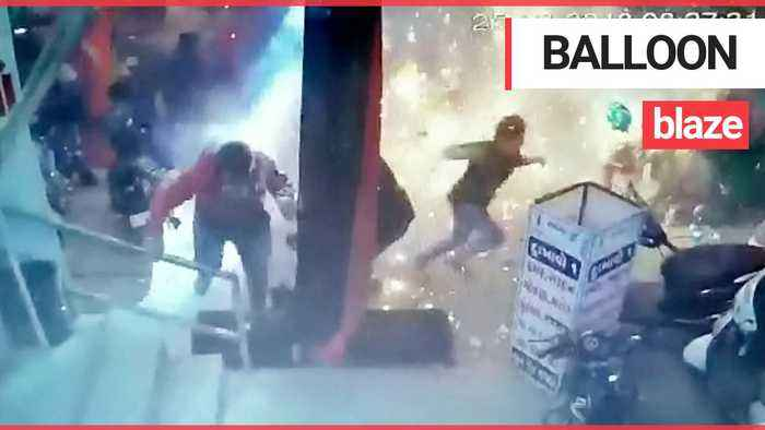 Shocking moment balloon seller causes inferno at Christmas market