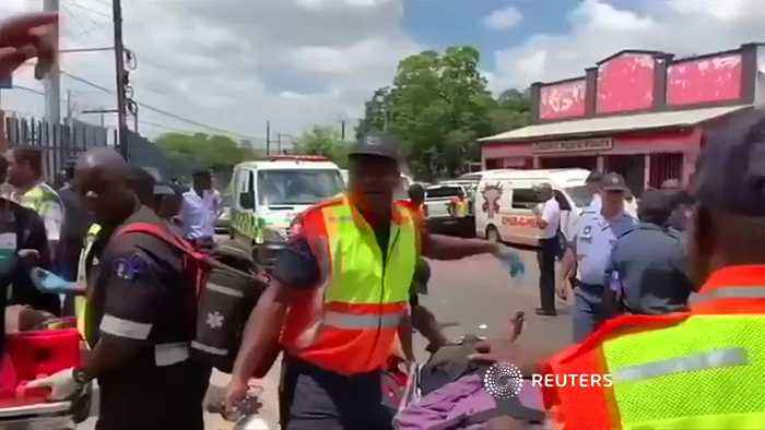 Wounded people are treated after South African train collision leaves at least two dead