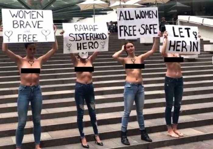 'Let Her In': Topless Protesters Rally For Saudi Refugee Rahaf Mohammed al-Qunun