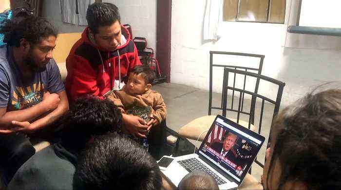 Central American migrants watch Trump's televised speech