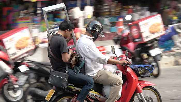 Motorcycle Passengers Carrying Strange Objects