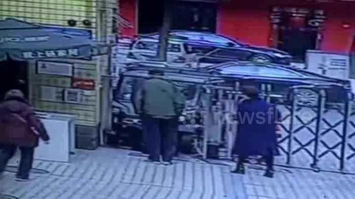 Car crashes into security guard as driver mistakes accelerator for brake