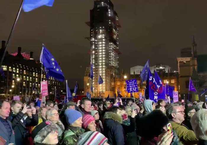 Crowd Cheers in London's Parliament Square After May's Brexit Vote Defeat