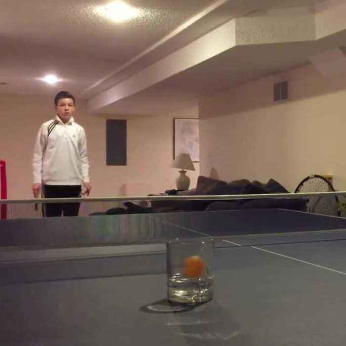 Guy Shoots Ping Pong Ball Straight Into Glass