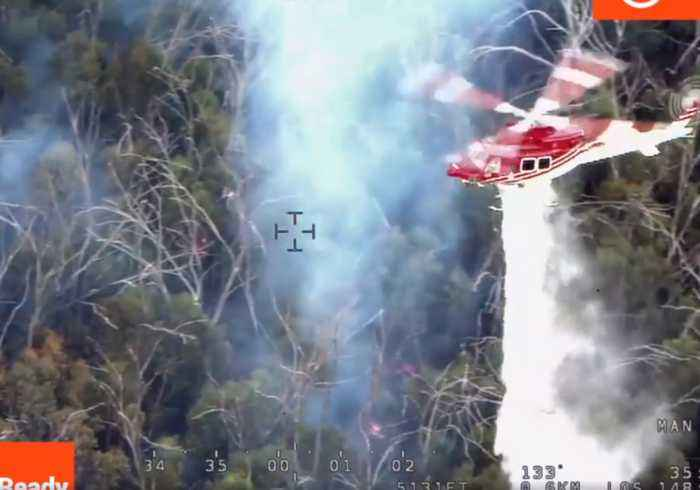 Fire Crews Use Helicopters to Waterbomb Bushfires Outside Canberra
