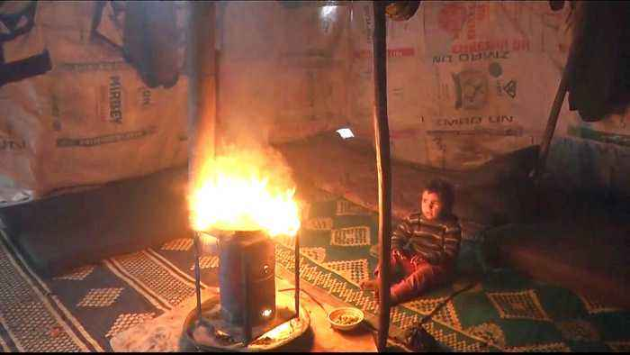 Syrian refugees burn plastic to survive harsh winter