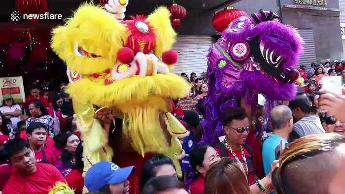 Tourists and locals enjoy colourful Chinese New Year celebrations in Manila