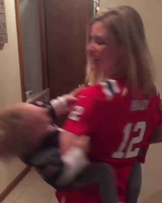 Mom Spins in Circles with Twin Babies to Celebrate Super Bowl