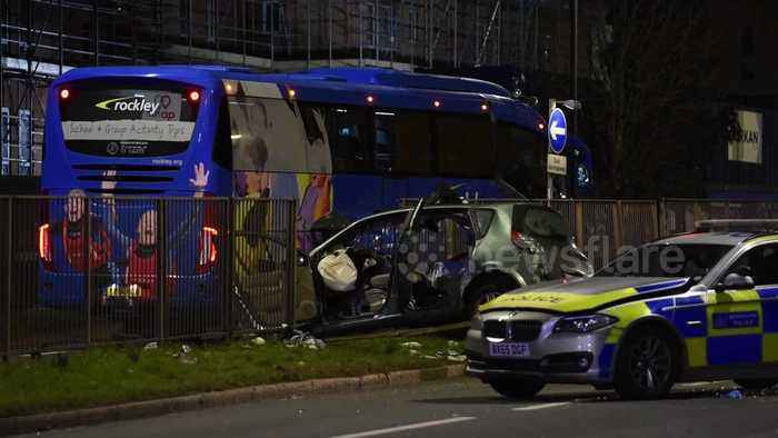 Two dead as car ploughs into coach after police pursuit in west London