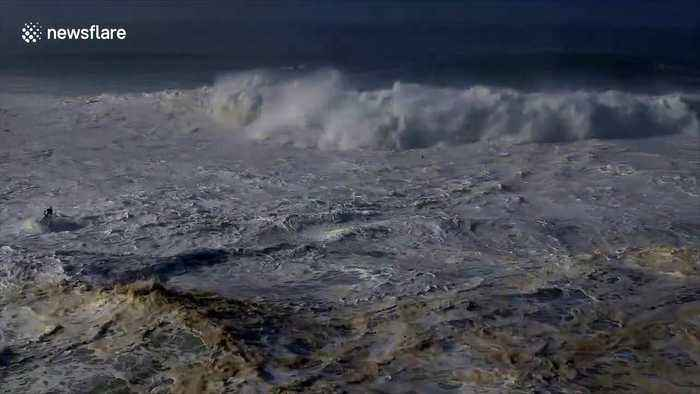 US surfer escapes terrifying wipe out in series of giant waves off Nazaré