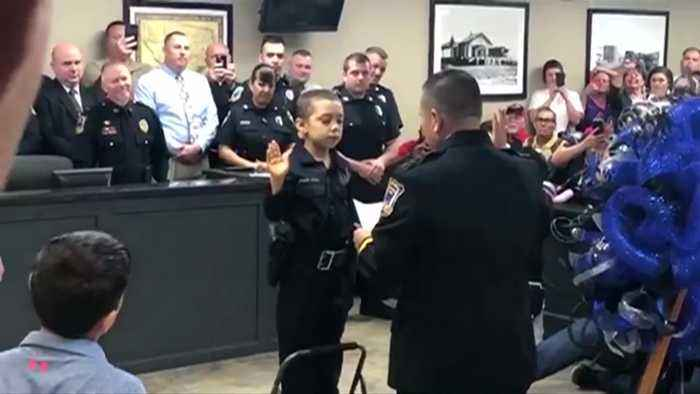 Young cancer patient becomes honorary police officer