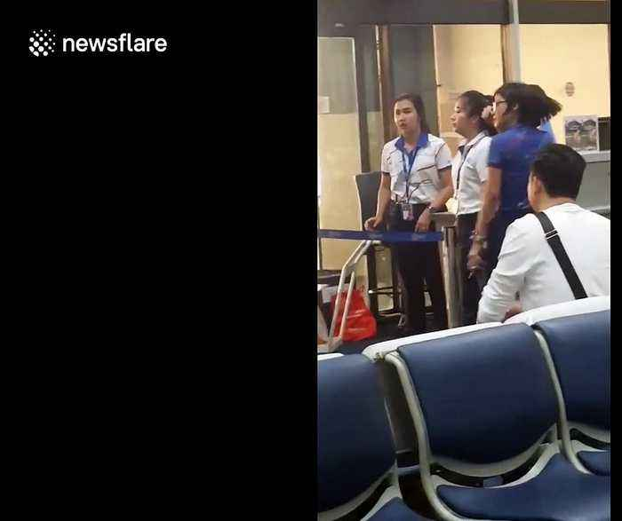 Furious Thai airport worker yells at tourist in row over hand luggage allowance