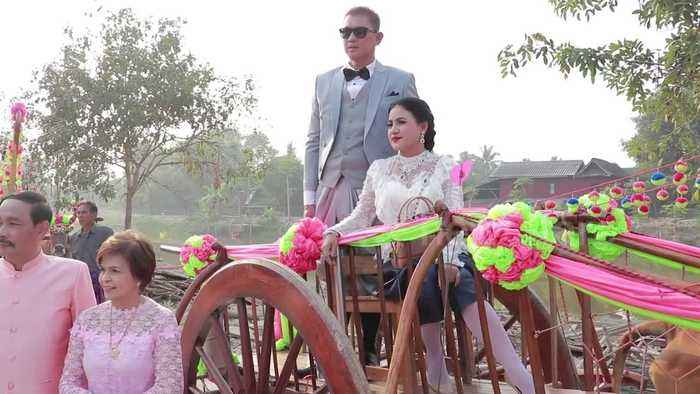 Couples get married in cow-drawn wooden carts to mark Valentine's Day
