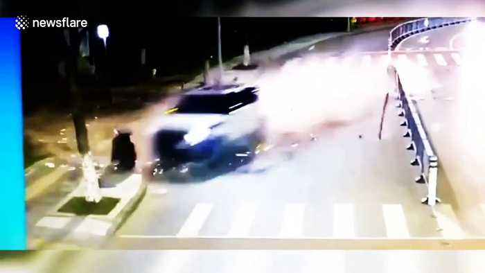 Man jogging on roadside has miraculous near miss from out-of-control car
