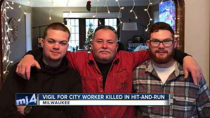 Community honors fallen DPW worker during city hall vigil