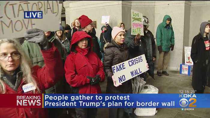 Protesters Rally Against Border Wall On City-County Building Steps