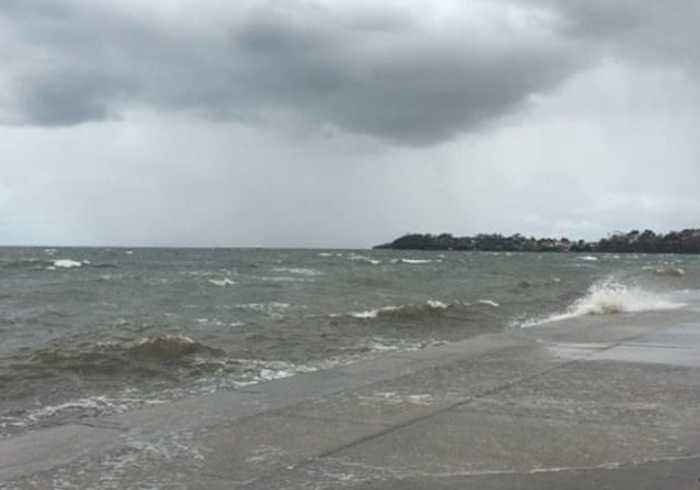 Waves Surge Over Seaside Footpath as Cyclone Oma Brings High Tides to Queensland