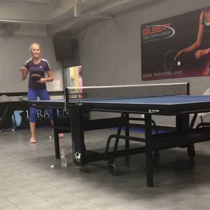 Female Table Tennis Coach Practices Back Hand Top Spin