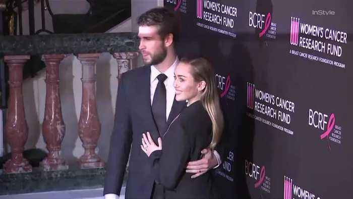 Miley Cyrus and Liam Hemsworth Couldn't Keep Their Hands Off Each Other on the Red Carpet