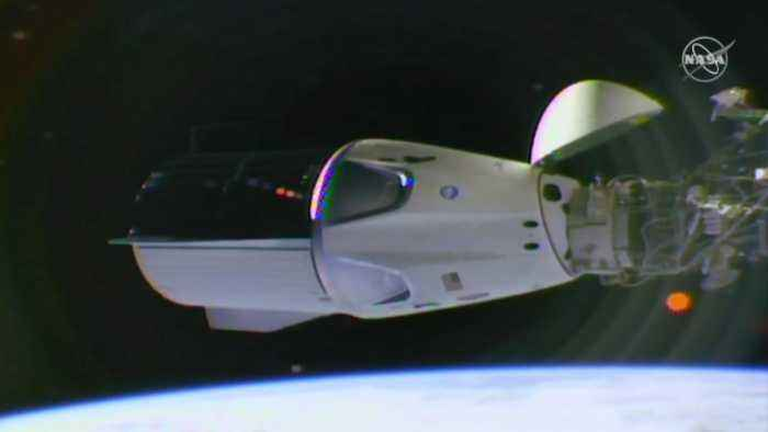 SpaceX Crew Capsule Docks at International Space Station