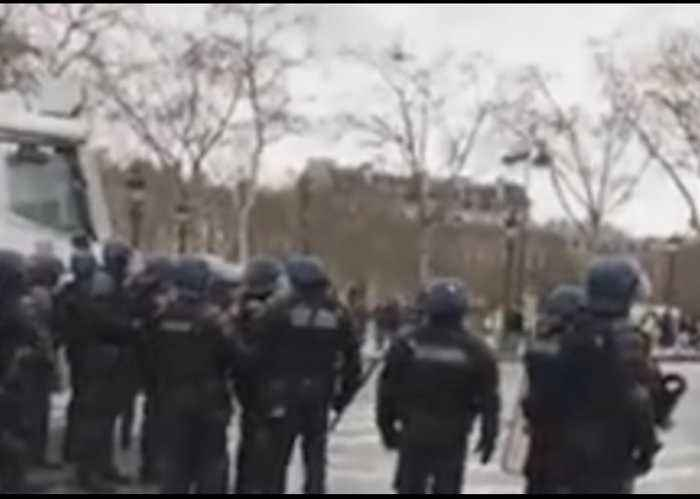 Riot Police Use Water Cannon to Disperse Protesters in Paris
