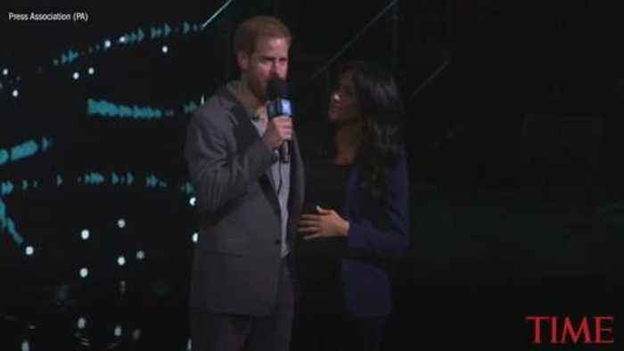 Prince Harry Shocks Crowd at Youth Event by 'Dragging' Meghan Markle on Stage