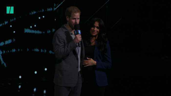Prince Harry Pulls Meghan On Stage At Youth Event