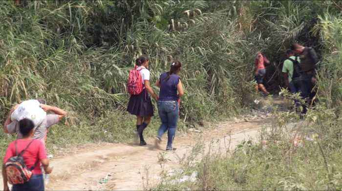 Venezuela children take risky trips to Colombia for school