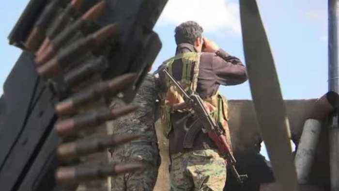 Armed Islamic State Fighters Watch Over Enclave Evacuations