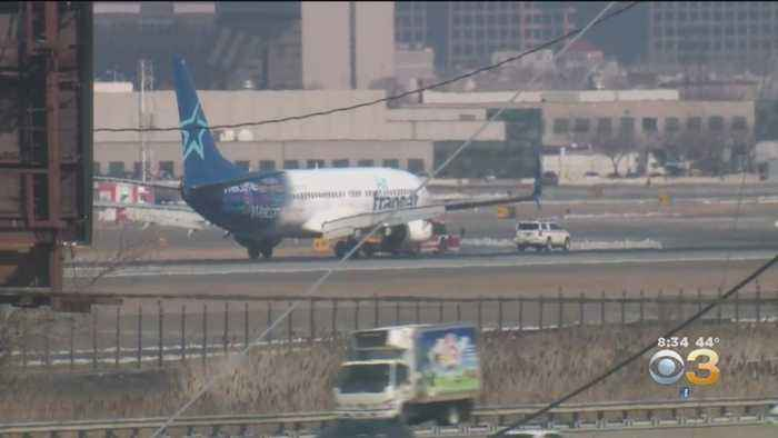 Passengers Slide To Safety After Emergency Landing At Newark Airport
