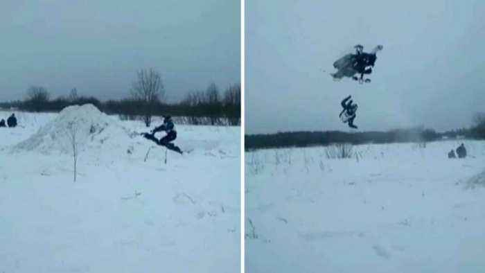 Snow painful! Unlucky daredevil breaks wrist after falling off snowmobile in mid air before vehicle lands on him