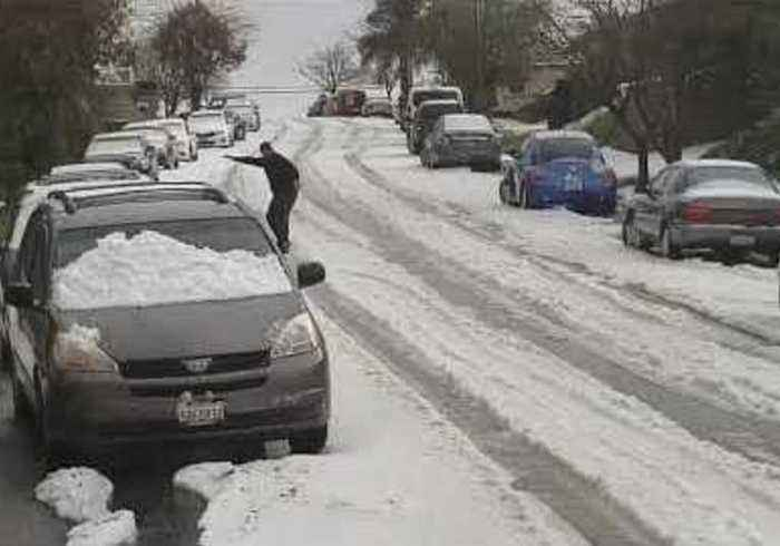 Hail Yeah: Snowboarder Surfs Down San Jose Street on Bed of Hailstones