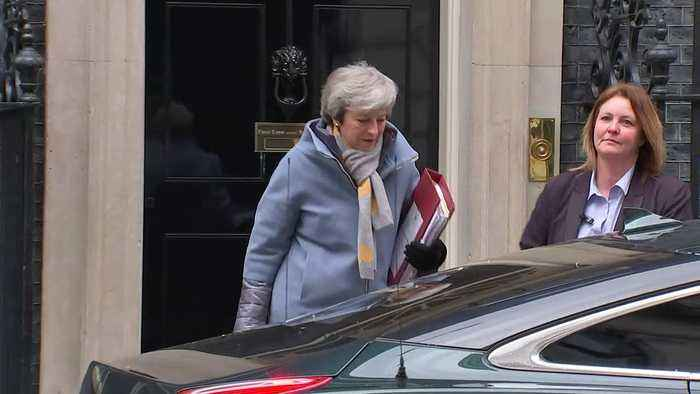Theresa May and Philip Hammond depart Downing Street