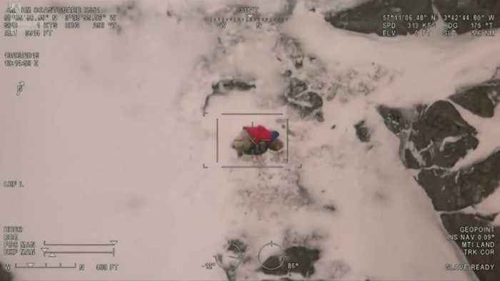 Helicopter footage shows dog's mountain rescue in Scotland