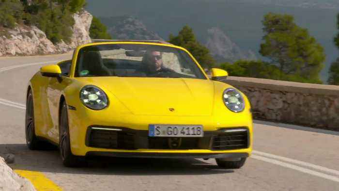 Porsche 911 Carrera 4S Cabriolet in Racing Yellow Driving Video