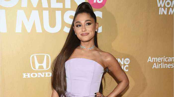 Ariana Grande got new ink that partially obscures a matching tattoo with Pete Davidson, but she insisted it's 'not a c
