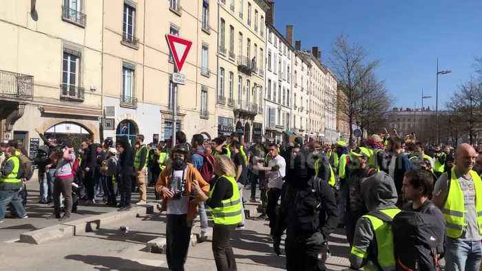 """Yellow vests"" clash with police on streets of Lyon, France"