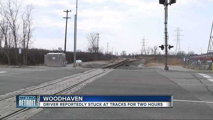 Man says he waited for more than 2 hours at train crossing in Woodhaven