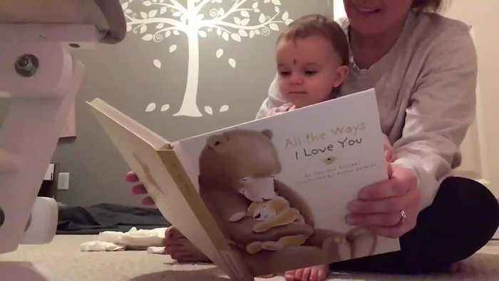 Baby Reacts Adorably Listening to Dad's Recorded Voice Reading to Her