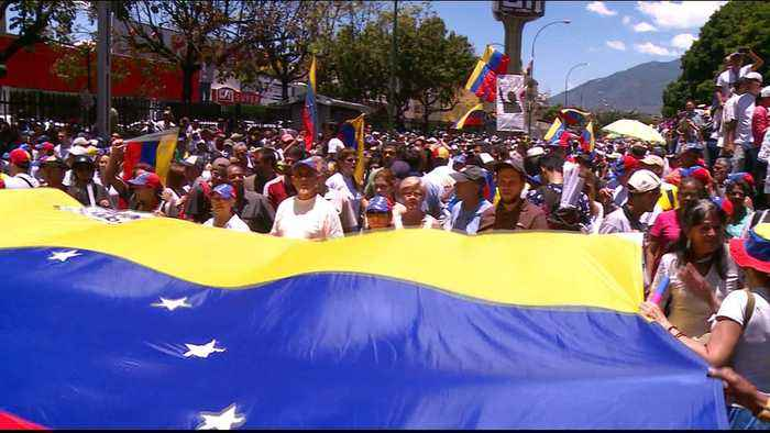 Venezuelans take to the streets as power struggle persists