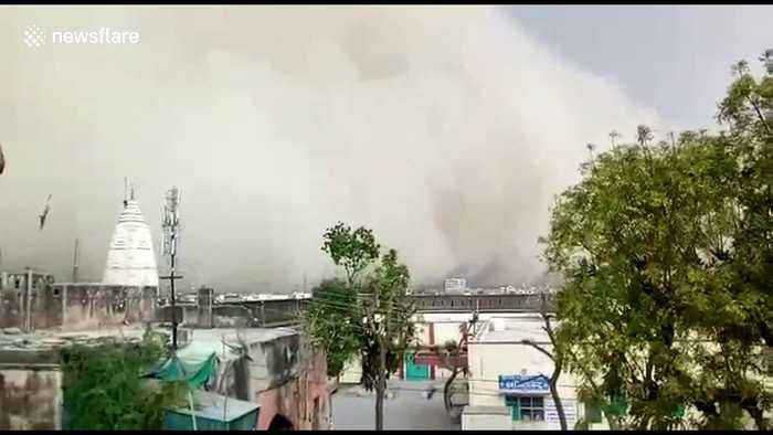 Skies turn dark as massive dust storm swallows up north Indian city