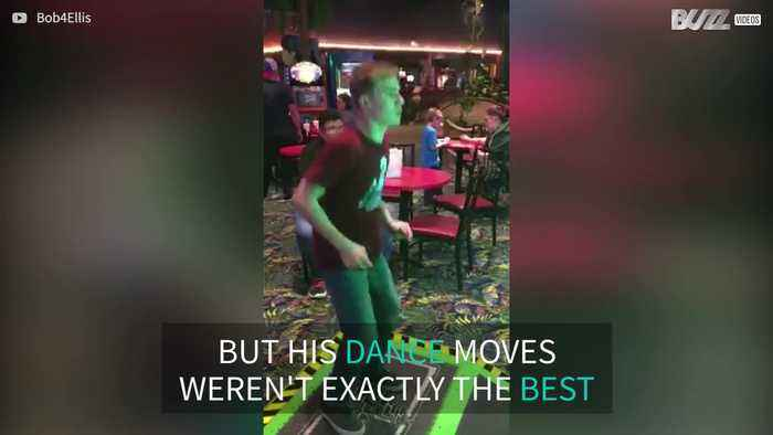 Teen gives his all in dance arcade game