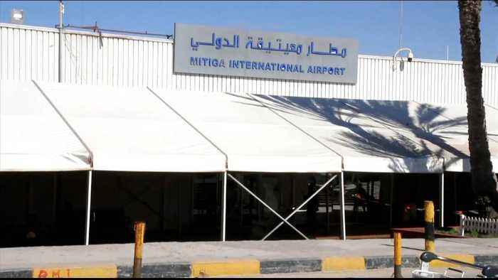 Tripoli's only functional airport hit by air raid as clashes rage