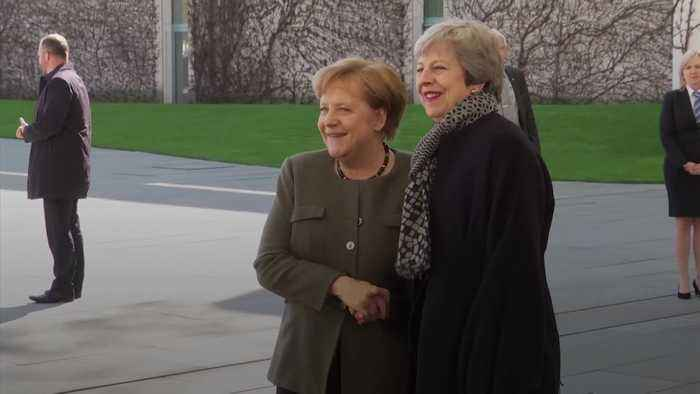 Theresa May arrives for Brexit talks with Angela Merkel