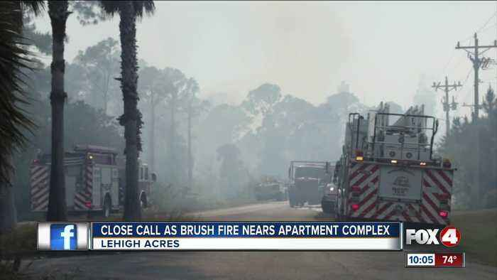 Brush fire near apartment complex in Lehigh Acres