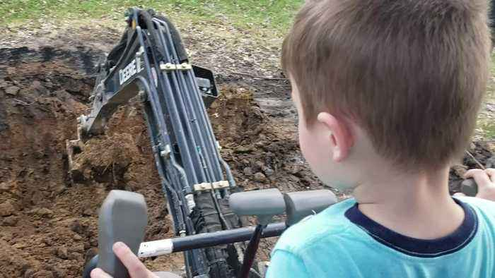 3-Year-Old Runs an Excavator