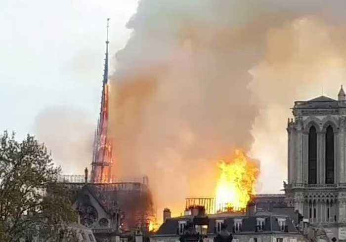 Spire on Notre Dame Cathedral Collapses Into Flames