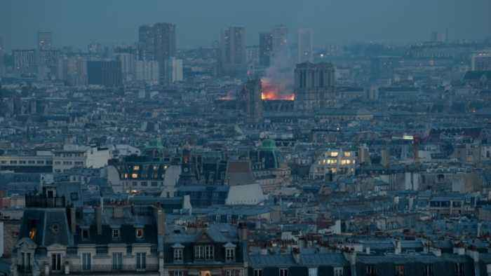 Witnesses watch as Notre Dame cathedrals burns in Paris